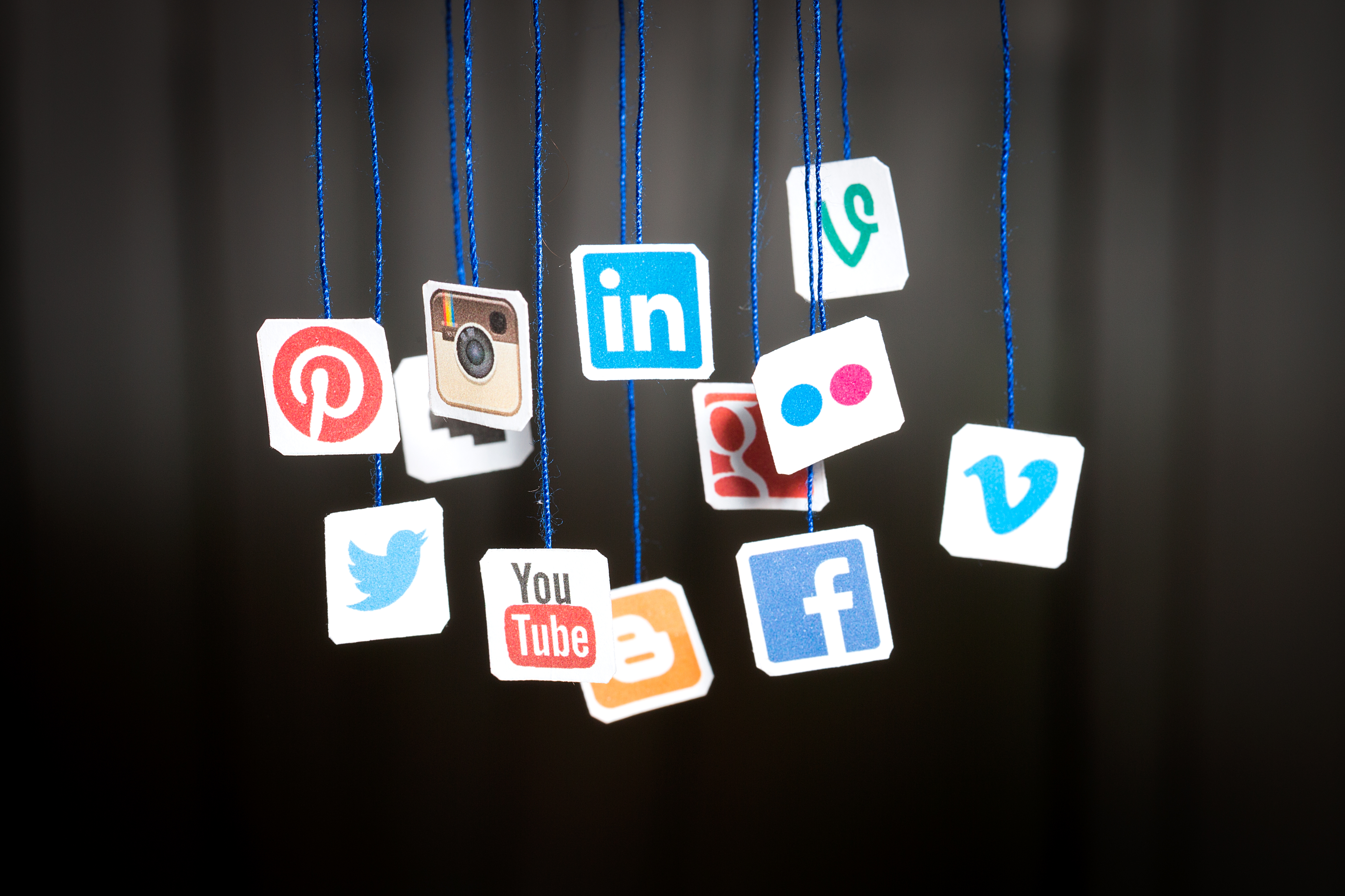 Popular social media website logos printed on paper and hanging 528343033 4637x3091